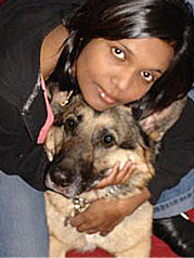 Lady in jeans with her dog