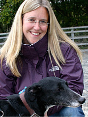 LAdy in pruple coat with her dog
